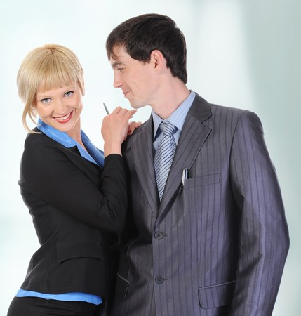 Beautiful blonde woman hugging a man in the suit. Isolated on white background Stock Photo - 7303279