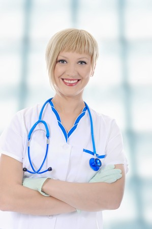 Young smiling nurse in uniform in his office Stock Photo - 7310750