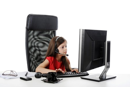 girl with astonishment looks in the monitor. Isolated on white background photo