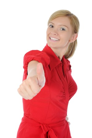 smiling girl in red with thumb up. Isolated on white background  photo