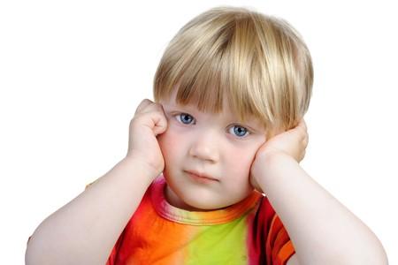 Thoughtful three year old girl. Isolated on white background photo