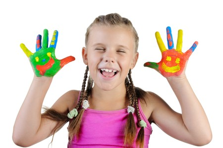 smiling girl with the palms painted by a paint. Isolated on white background Stock Photo - 7539589