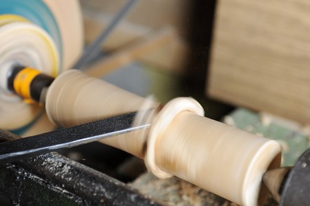 wood shavings: Product manufacturing on the lathe Stock Photo