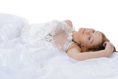 Young bride lying on the floor. Isolated on white background Stock Photo - 7539578
