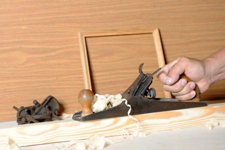 Master handles pine board a plane photo