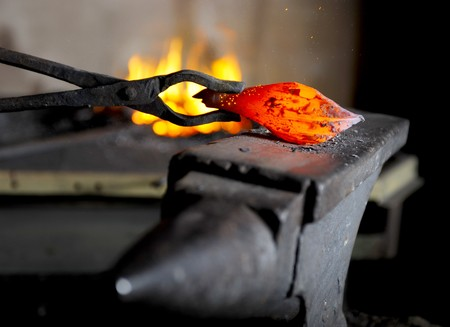 Incandescent element in the smithy on the anvil Stock Photo - 7545744