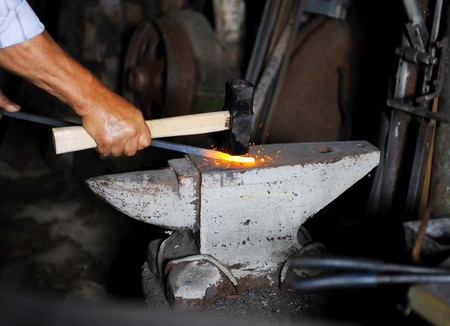 Making a decorative pattern in the smithy photo