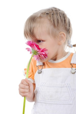 red head girl: girl sniffs a flower. Isolated on white background