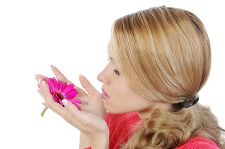 woman with flower in her hand. Isolated on white background photo