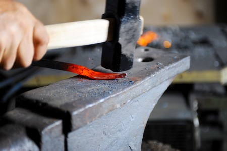 Blacksmith forges a hot spear on the anvil Stock Photo - 7545754