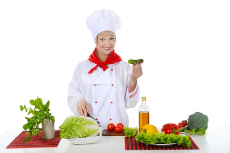 smiling chef with a cucumber. Isolated on white background photo