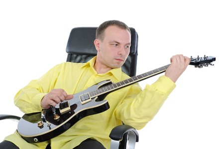 man with a black guitar. Isolated on white background photo