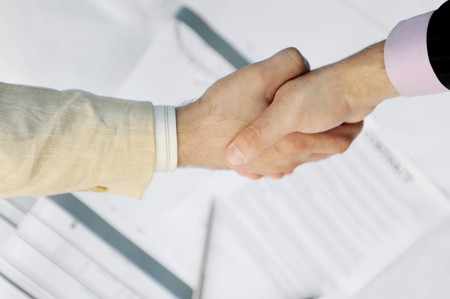 Handshake of two business partners in black and white suits Stock Photo - 7545770