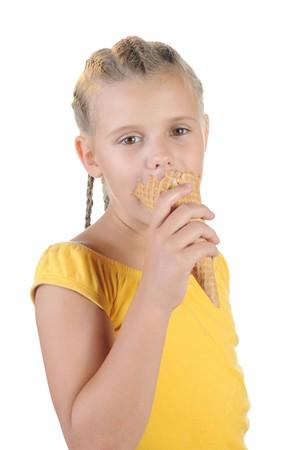 Girl eating ice cream. Isolated on a white background Stock Photo - 7563980
