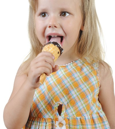 Girl eating ice cream. Isolated on a white background Stock Photo - 7563994