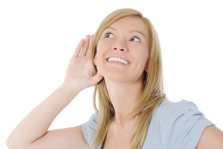 hearsay: Smiling women listening news. Isolated on white background Stock Photo