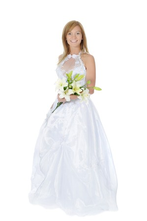 Happy bride with a bouquet of lilies. Isolated on white background photo