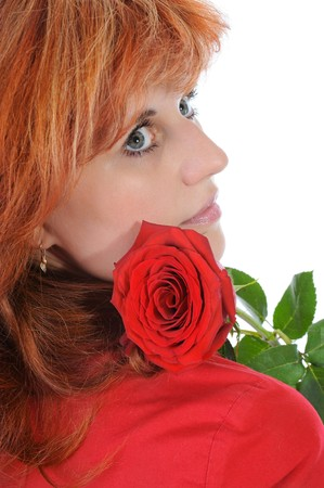 red-haired women with a rose. Isolated on white background photo