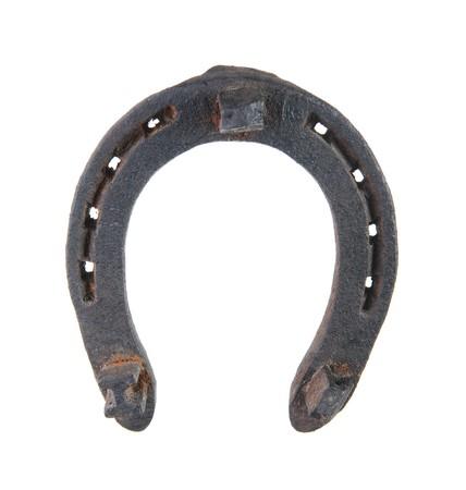 horseshoe: Old horseshoe close-up. Isolated on white background