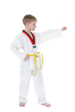 Boy in a kimono. Isolated on white background photo