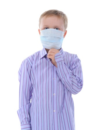 Boy in the medical mask. Isolated on white background photo