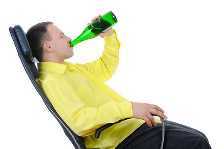 man drinking alcohol. Isolated on white background photo