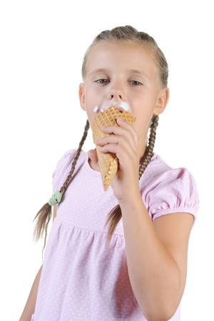 girl eating ice cream.. Isolated on a white background photo