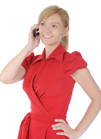 woman in red with a phone in his hand. Isolated on white background photo