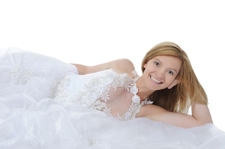 Happy bride lying on the floor. Isolated on white background photo