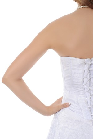 brides white corset. Isolated on white background photo