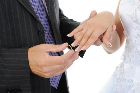 groom wears the ring bride. Isolated on white background Stock Photo - 7634411