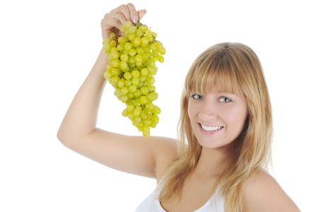 Girl with green grapes. Isolated on white background photo