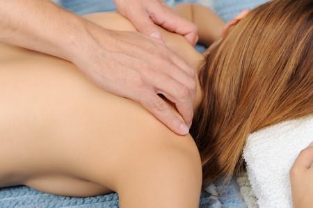 Young beautiful brunette woman on massage back photo