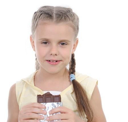 girl eating chocolate. Isolated on white background Stock Photo - 7634429