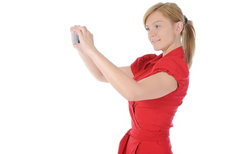 woman takes a picture to your phone. Isolated on white background photo