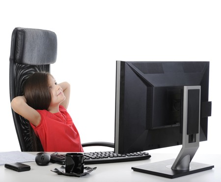 girl in the office in front of computer. Isolated on white background photo