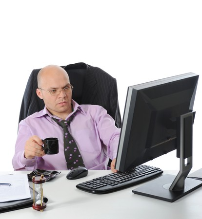 man sitting before a computer. Isolated on white background photo