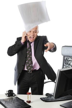 Nervous businessman talking on the phone.. Isolated on white background Stock Photo - 7701418
