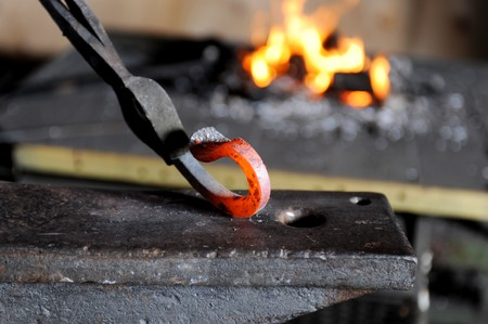 smithy: Incandescent element in the smithy on the anvil