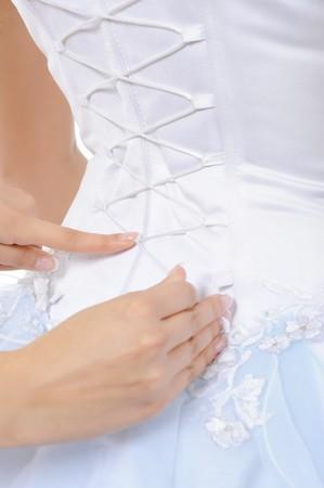 Silk Corset Bride. Isolated on white background photo
