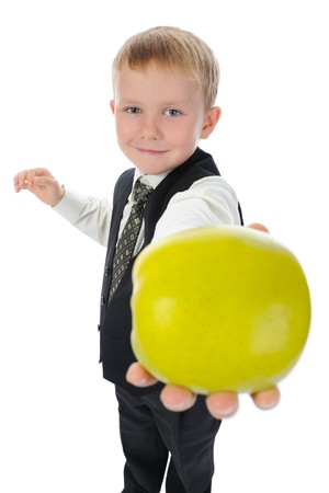 waistcoat: boy holds out an apple. Isolated on white background