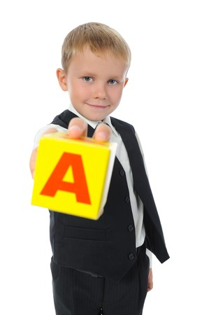 waistcoat: boy holds a cube. Isolated on white background