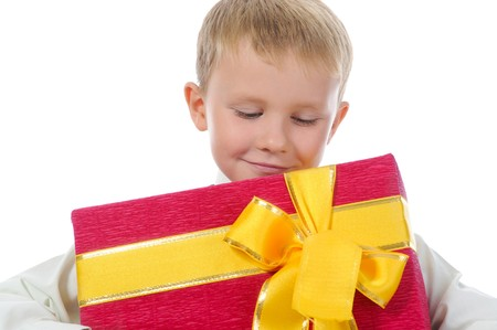boy holding present box . Isolated on white background photo