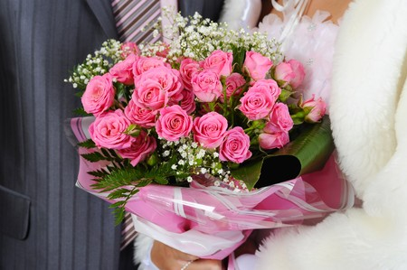Married with a bouquet of pink roses photo
