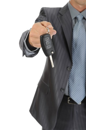 gives: Businessman gives the keys to the car. Isolated on white background