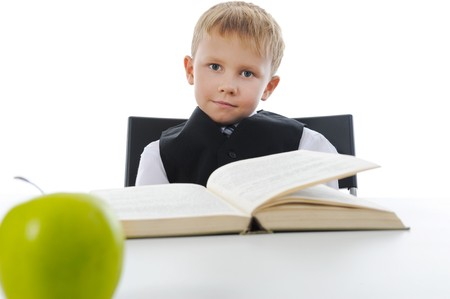 Boy with book. Isolated on white background photo