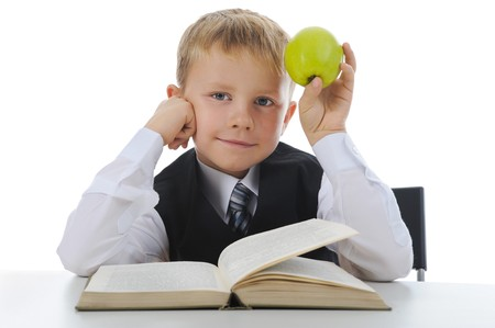 Boy with green apple. Isolated on white background photo