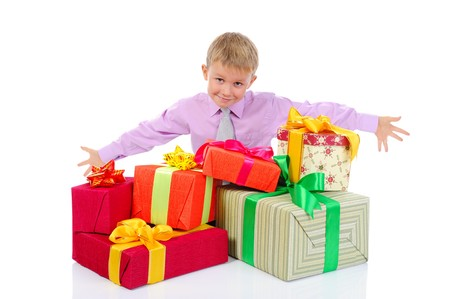 boy with a bunch of gifts . Isolated on white background Stock Photo - 7701638