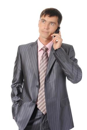 Businessman talking on the phone. Isolated on white background Stock Photo - 7701651