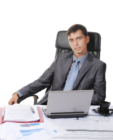 Businessman sitting before a laptop. Isolated on white background Stock Photo - 7701616